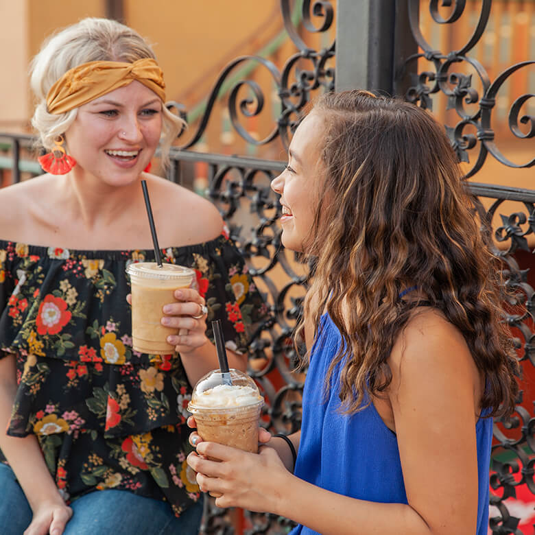 Female Big and Little laughing and drinking iced coffee