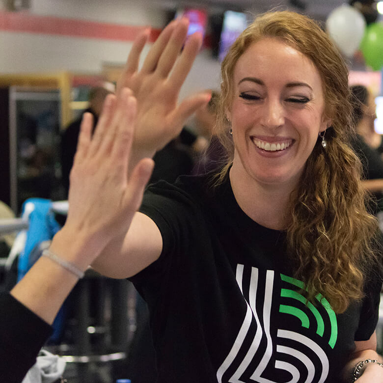 Participant giving a high five at a BBBS event